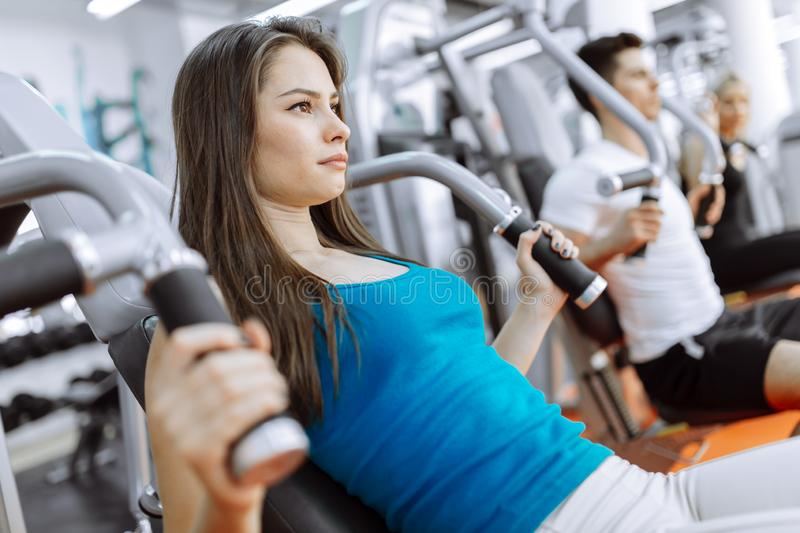 People exercising in gym stock photos