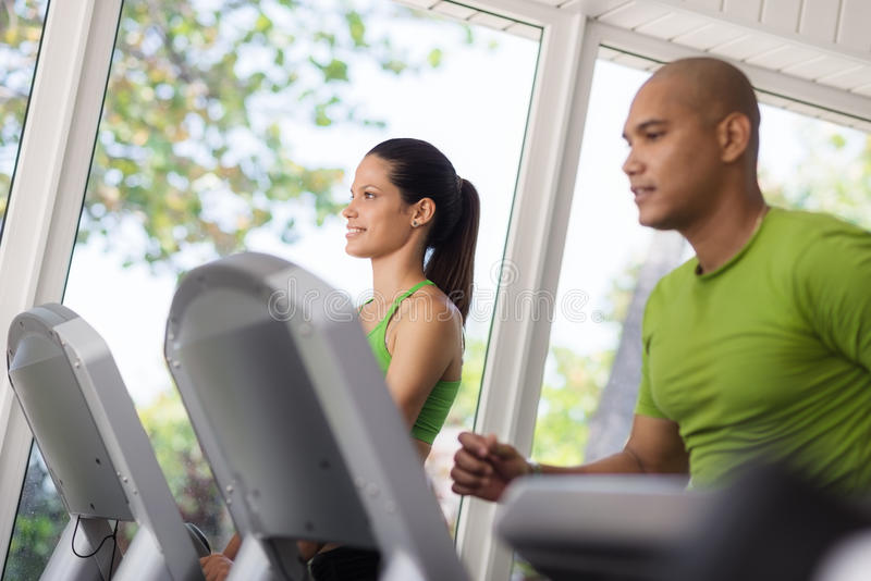 Download People Exercising And Running On Treadmill In Gym Stock Image - Image: 25578983