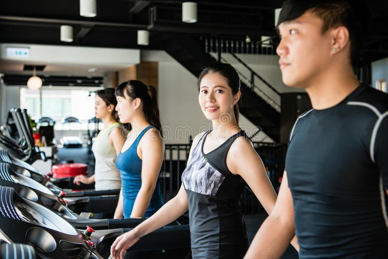 Woman exercising on treadmill and smiling royalty free stock photos