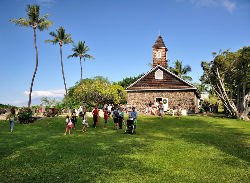 People exiting from the church. People exiting from a small Hawaiian church after the Sunday Mass stock images