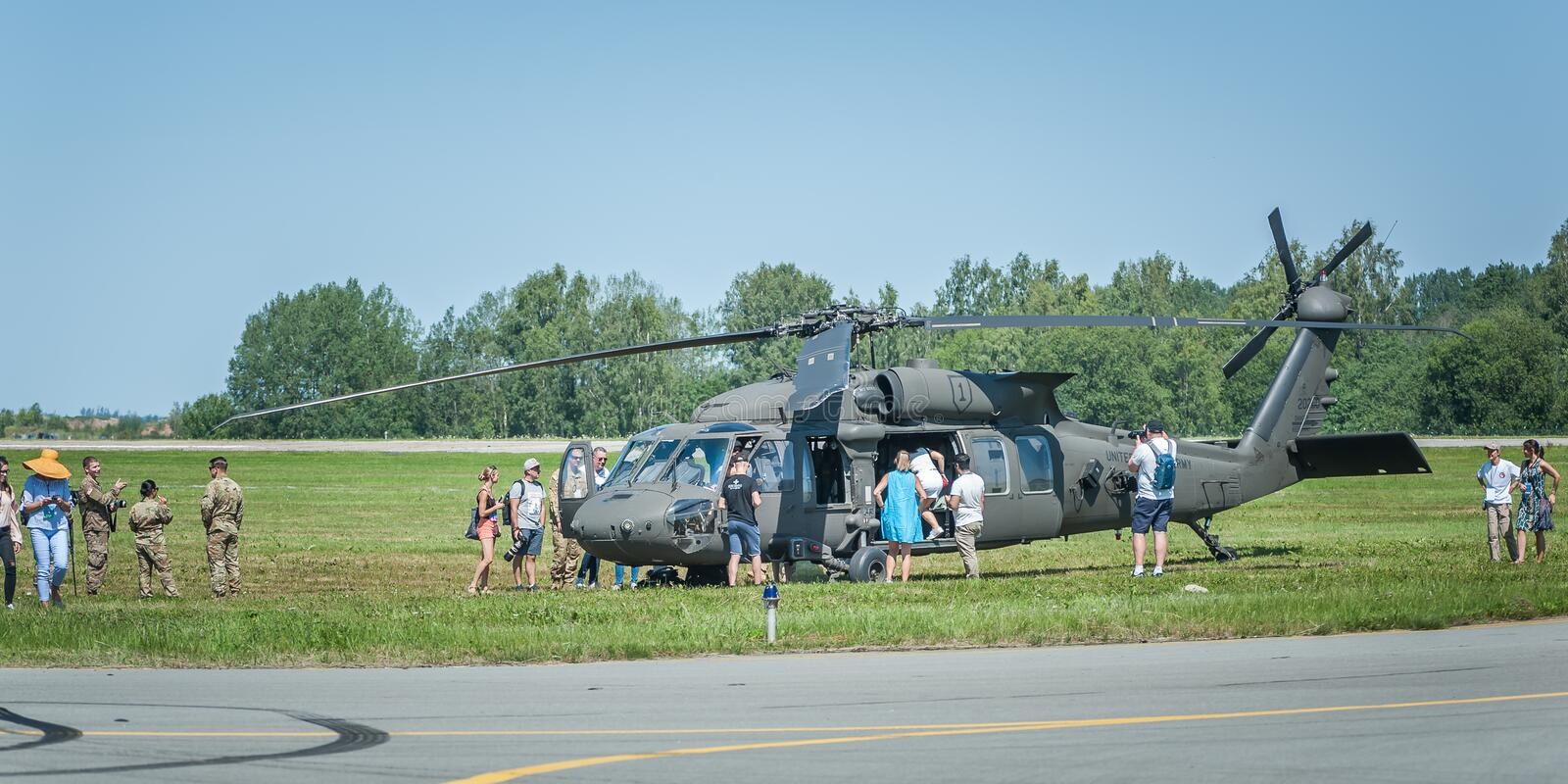 People explore the helicopter at the airshow royalty free stock photography