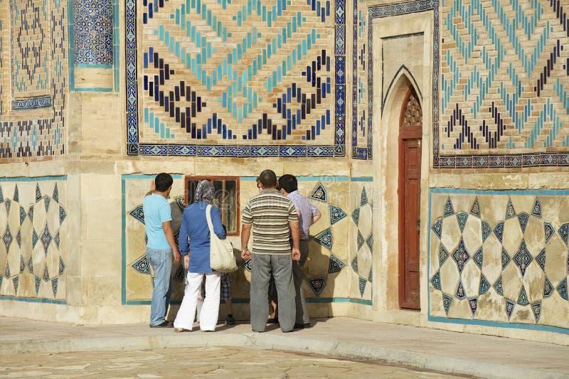 People explore mausoleum of Khoja Ahmed Yasavi in Turkistan, Kazakhstan. TURKISTAN, KAZAKHSTAN - SEPTEMBER 20, 2011: Unidentified people explore the medieval stock photography