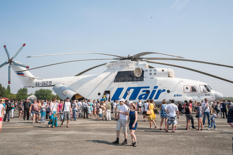 People explore the MI-26T helicopter stock photo