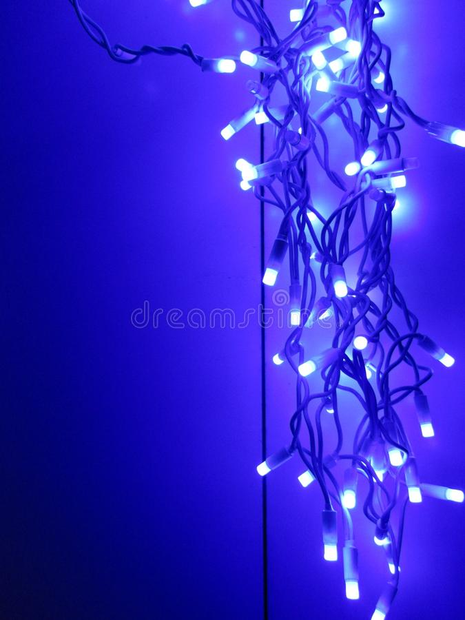 Beautiful blue light burning on the wall royalty free stock images