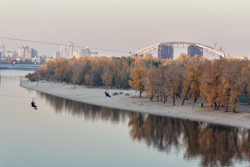 People fall on a rope across the river. Kiev stock image