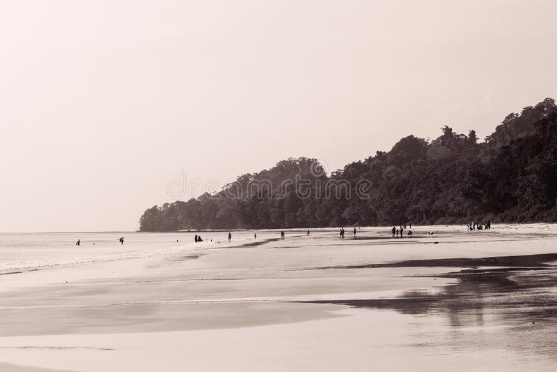 People far away at Radhanagar beach stock images