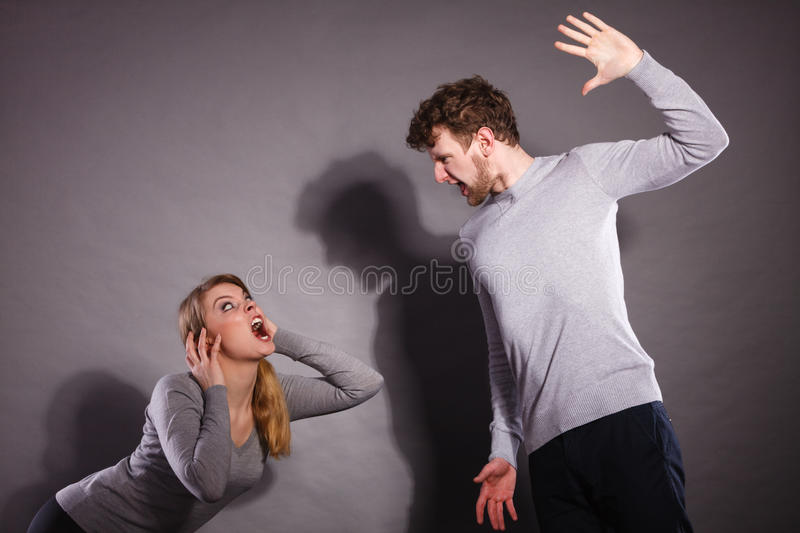 People in fight. Young couple arguing. Negative emotions concept. People in fight. Husband and wife arguing and yelling on each other. Expressive and emotional royalty free stock photos