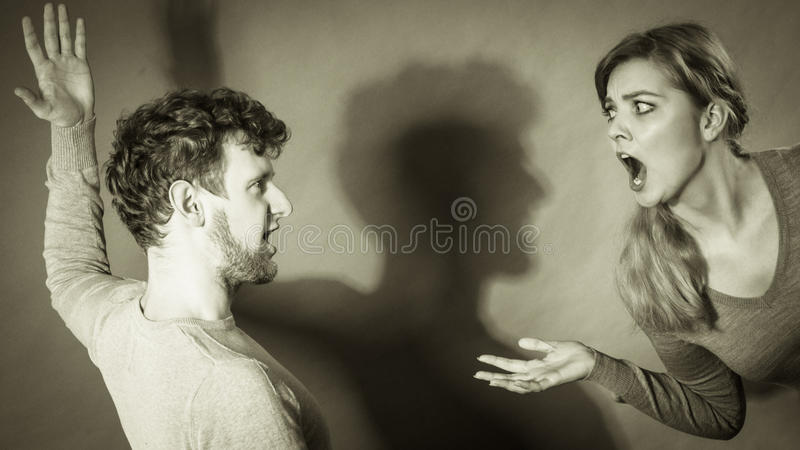 People in fight. Young couple arguing. Negative emotions concept. People in fight. Husband and wife arguing and yelling on each other. Expressive and emotional royalty free stock photo