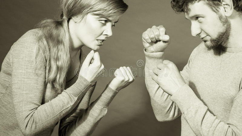 People in fight. Young couple arguing. Negative emotions concept. People in fight. Husband and wife arguing and yelling on each other. Expressive and emotional royalty free stock image