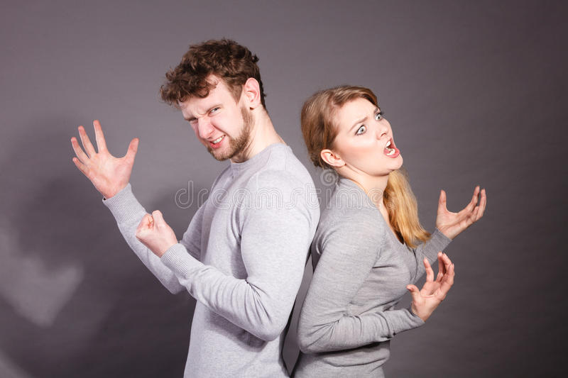 People in fight. Young couple arguing. Negative emotions concept. People in fight. Husband and wife arguing and yelling on each other. Expressive and emotional stock image