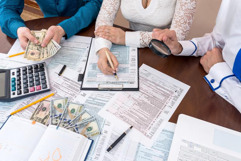 People filling 1040 form helping each other.  royalty free stock photos