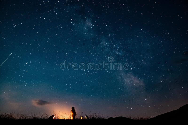 People by fire camp with Milky Way on the sky near Durmitor in Montenegro, Europe royalty free stock photos