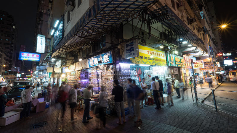 People at fish market in Hong Kong stock images