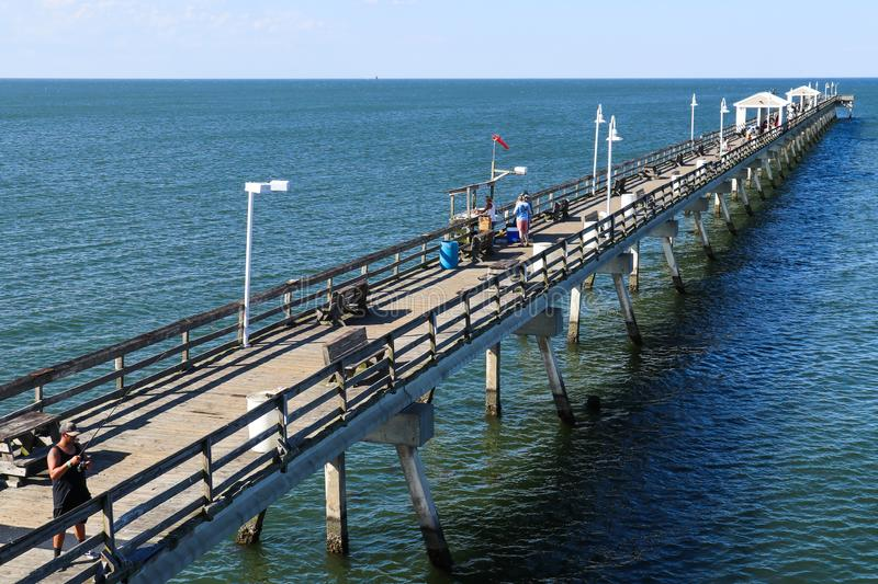 People Fish on Ocean View Fishing Pier in Norfolk, VA royalty free stock photo