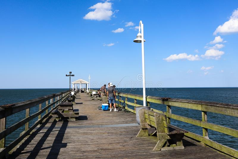 People Fish on Ocean View Pier in Norfolk, VA stock photography