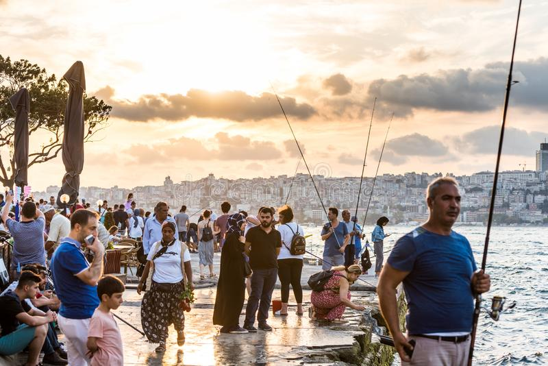 People fishing at the Corniche park at Uskudar, Istanbul, Turkey, on the Anatolian shore of the Bosphorus.  royalty free stock images
