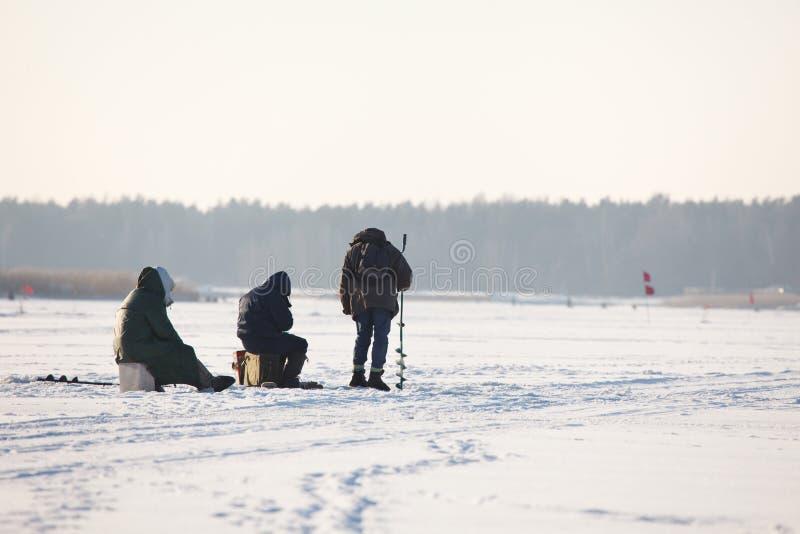 People fishing on ice stock image