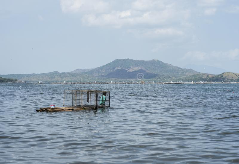 People fishing in the Taal volcano`s lake in Batangas, the Philippines.  royalty free stock images