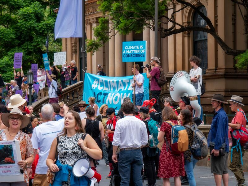 People with Flags and banners at a Climate Change Protest in Sydney. royalty free stock photo