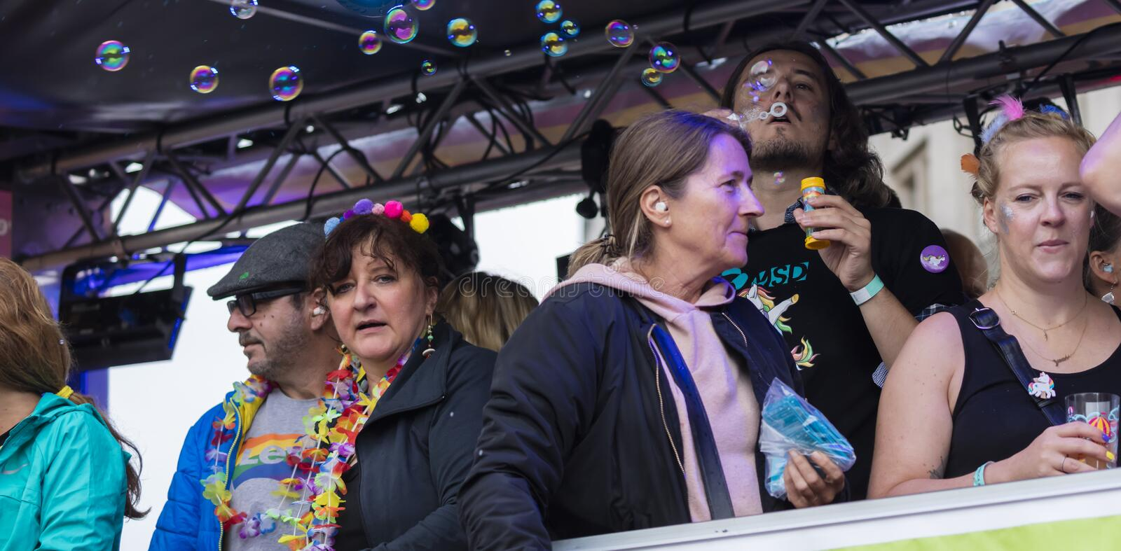 People on a float attending the Gay Pride parade also known as Christopher Street Day CSD in Munich, Germany. 2019: People on a float attending the Gay Pride royalty free stock photo