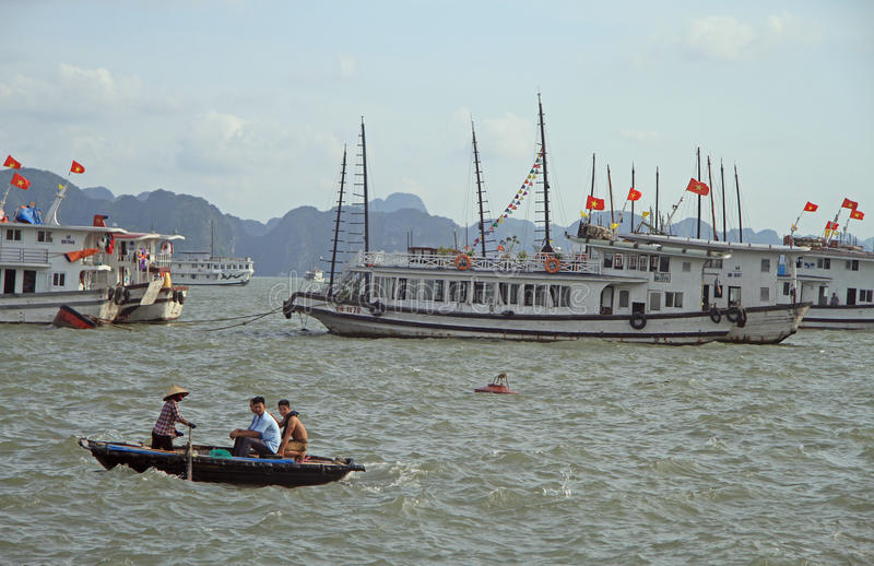 Download People Are Floating In Boat By Ha Long Bay, Vietnam Editorial Image - Image: 83717815