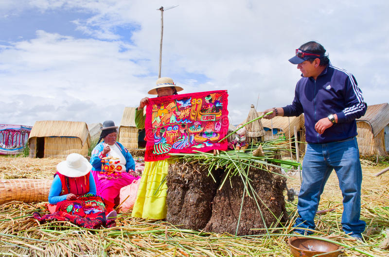 People on floating Uros islands on lake Titicaca in Peru stock photo