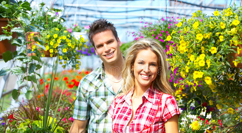 People florists. Young smiling people florists working in the garden royalty free stock photos