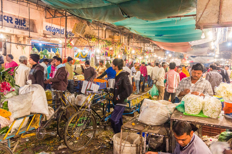 People in the flower market in the early morning. This picture was taken in Ahmedabad flower market during early morning
