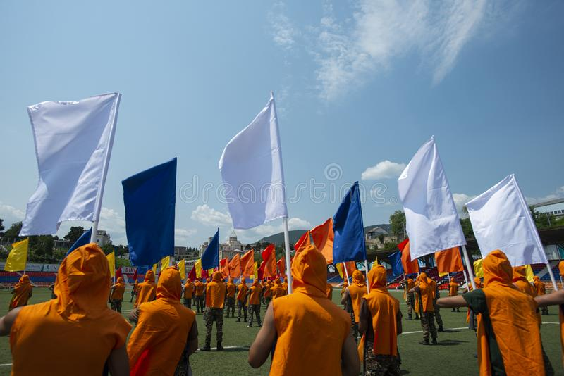 People flying flags in a ceremony. Stepanakert, armenia stock photo