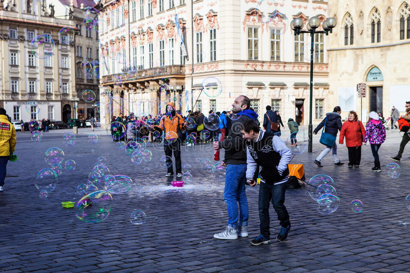 People flying soap bubbles forming Old Town Square Prague, Czech Republic. CZECH REPUBLIC, PRAG OLD TOWN SQUARE, MARCH 5: flying soap bubbles, Old Town Square royalty free stock photos