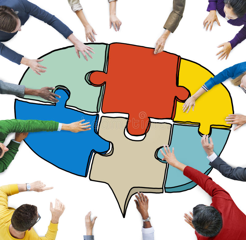 People Forming a Jigsaw Puzzle Speech Bubble. Business People Forming a Jigsaw Puzzle Speech Bubble royalty free stock images