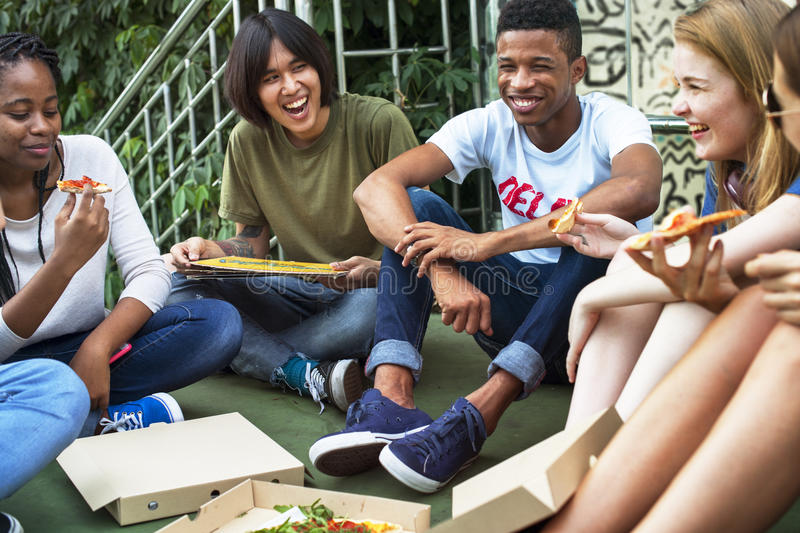 People Friendship Togetherness Eating Pizza Youth Culture Concept stock images