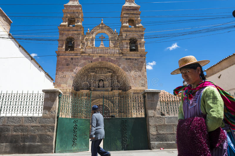 People in front of a church in the city of Potosi in Bolivia. Potosi, Bolivia - November 29, 2013: People in front of a church in the city of Potosi in Bolivia royalty free stock images
