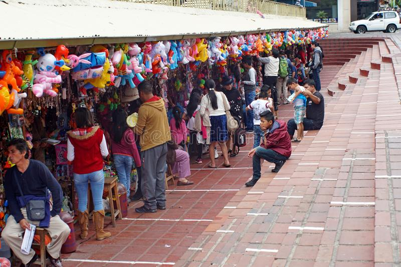 People in front of a church. Crowd of people at shops in front of a church in Banos, Ecuador royalty free stock photography