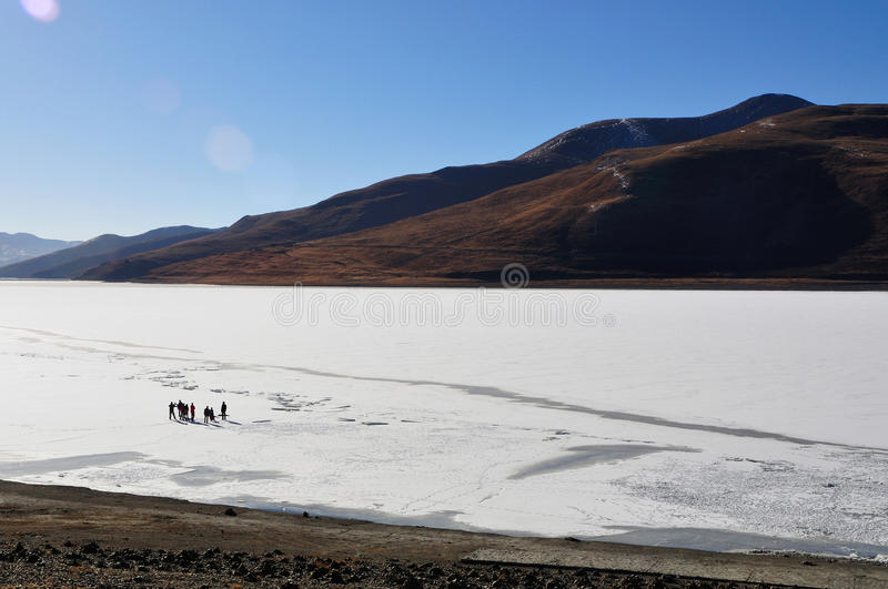 People and Frozen Lake. People are standing on the frozen lake in Qinghai-Tibet Plateau. Taken in Yangzhuoyongcuo Lake in Tibet, China.Yamdroktso Lake is located royalty free stock image