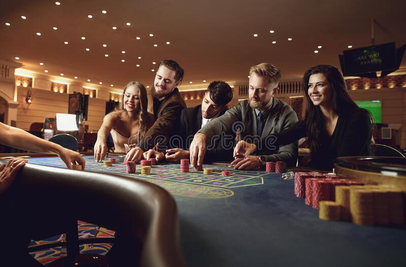People gamble at night at the roulette table in a casino. Gambling betting in a casino. People gamble at night at the roulette table in a casino stock photos