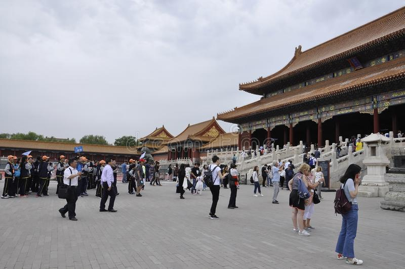 Beijing, 5th may: Gate of Supreme Harmony from the Forbidden City in Beijing. People at the Gate of the supreme Harmony from Forbidden City Chinese imperial stock image