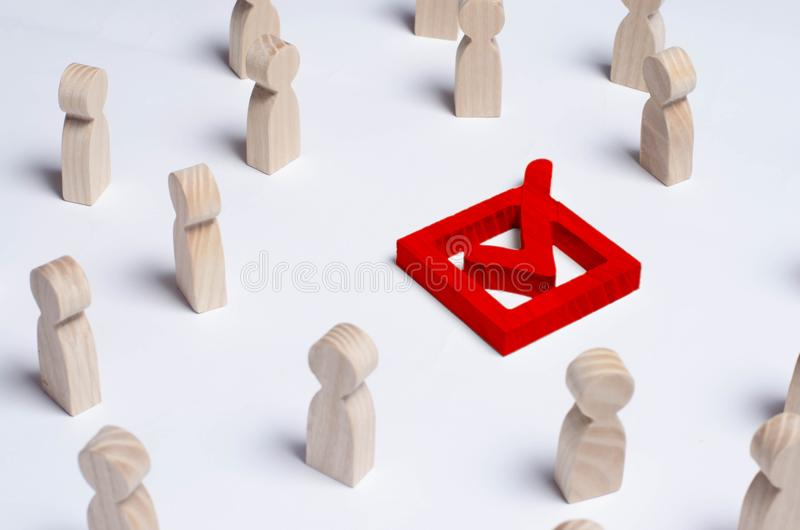 People gathered around the checkbox on a white background. People make a group choice. Democratic elections, collective decision a stock image