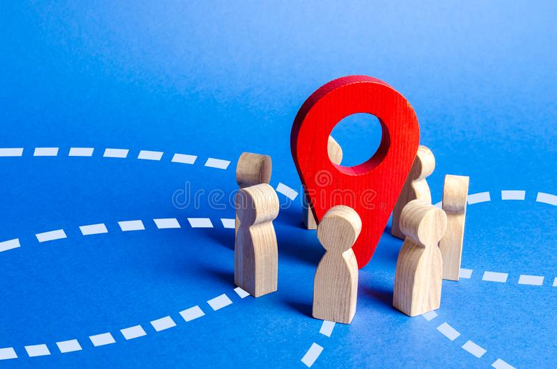 People gathered around the red navigation pointer pin. Meeting place concept. A long awaited meeting, a company of friends royalty free stock photo
