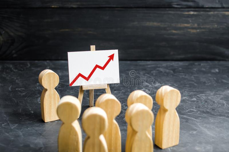 People gathered for a meeting and look at the speech of the leader. Meeting or report for the past period. Analytics and strategy royalty free stock photo