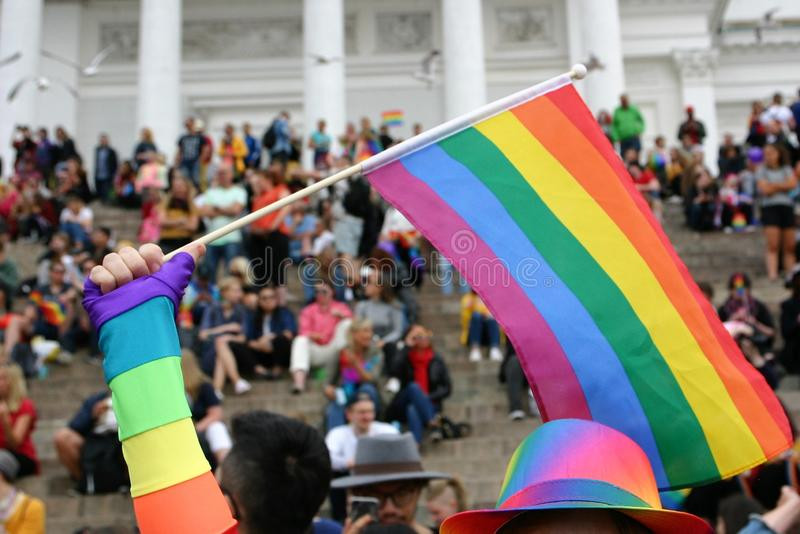 People are gathered on the steps of Helsinki Cathedral to wait for the Pride parade to start royalty free stock photos