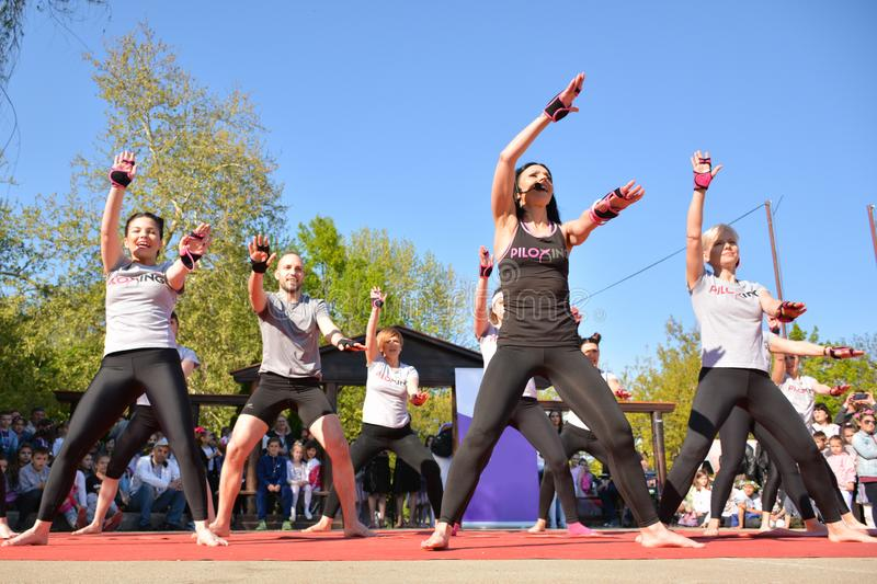 People gathered to perform Piloxing training during the day, outdoor sport activities on sunny spring day royalty free stock images