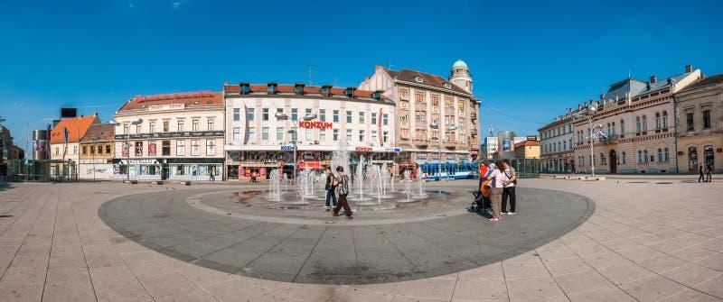 People gathering around fountain on the main square of Osijek stock image