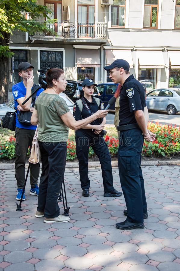 People gathering near  monument of reverence for police who become victims of criminals. Odessa, UKRAINE – AUGUST 22, 2019: People gathering royalty free stock images