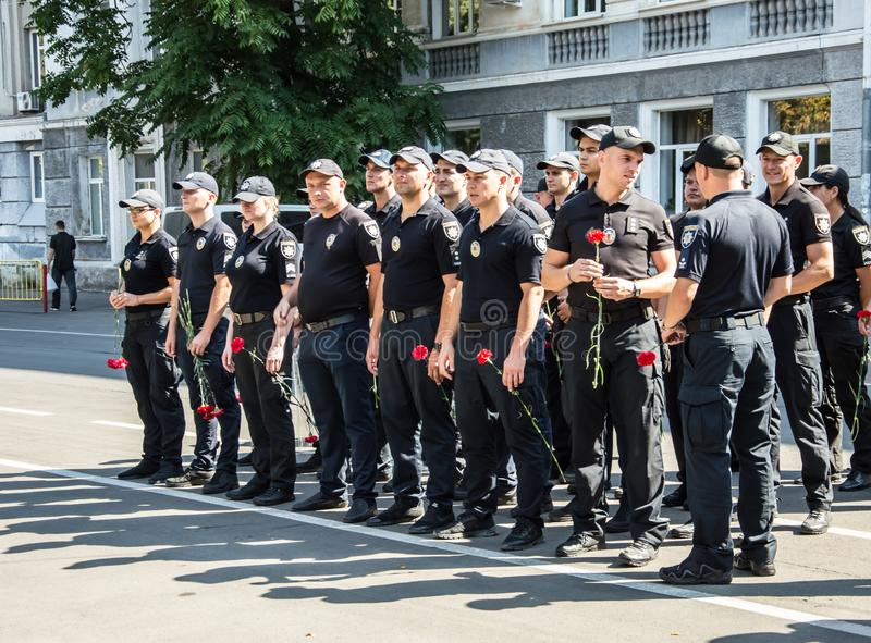 People gathering near  monument of reverence for police who become victims of criminals. Odessa, UKRAINE – AUGUST 22, 2019: People gathering stock photos