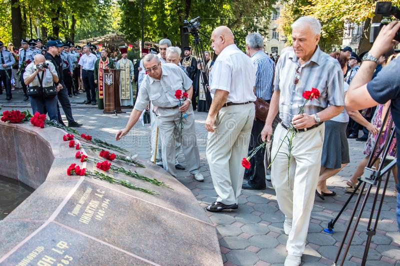 People gathering near  monument of reverence for police who become victims of criminals. Odessa, UKRAINE – AUGUST 22, 2019: People gathering royalty free stock image