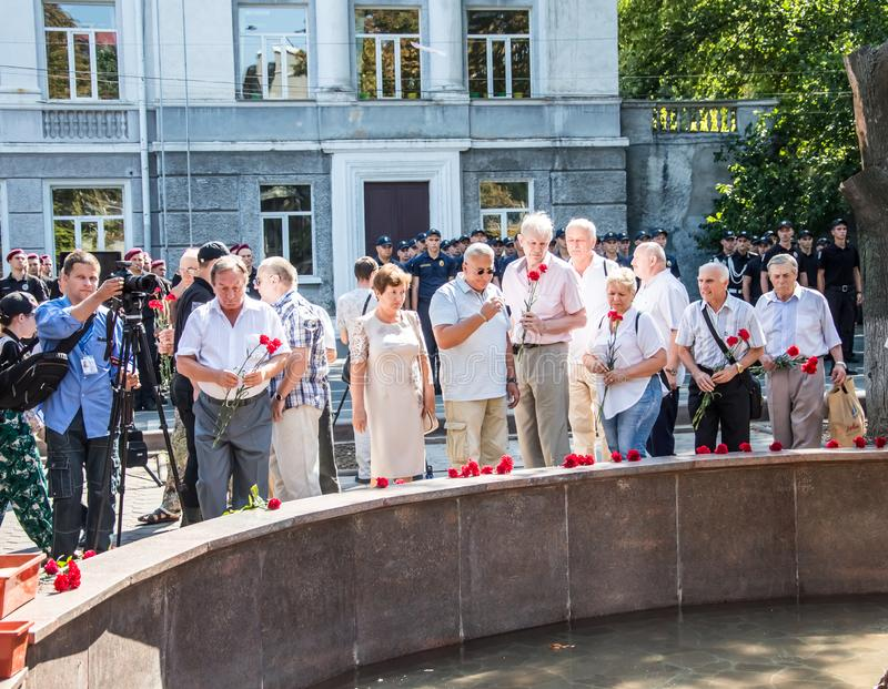 People gathering near  monument of reverence for police who become victims of criminals. Odessa, UKRAINE – AUGUST 22, 2019: People gathering stock photography