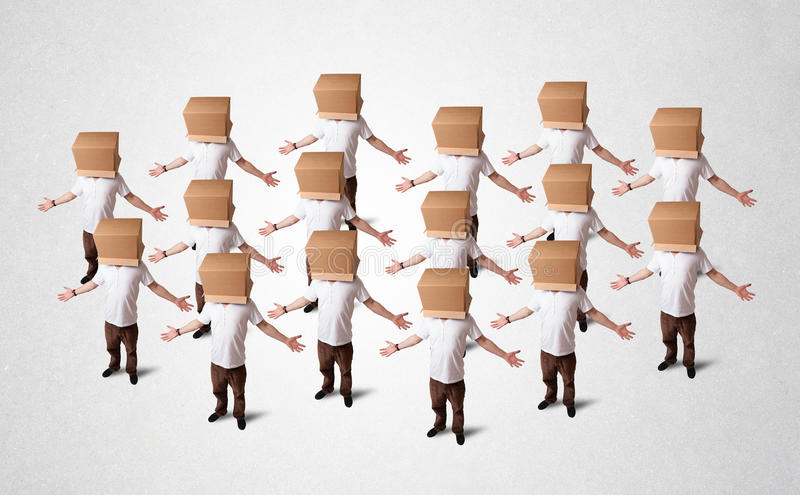 People gesturing with empty box on their head. Group of people gesturing with empty box on their head royalty free stock image