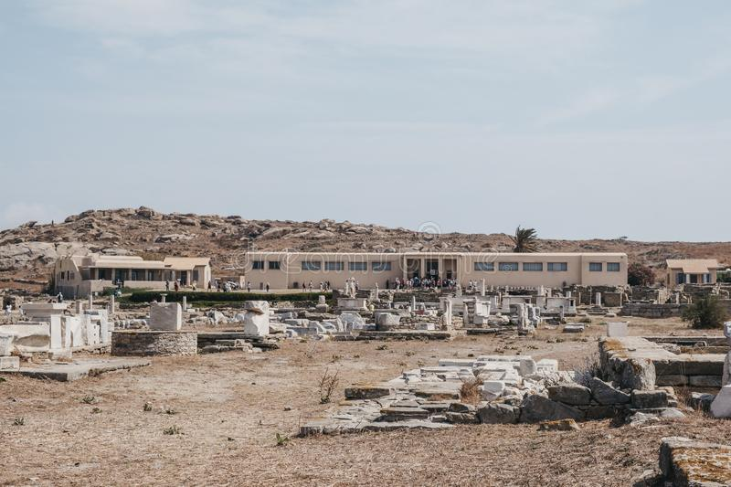 People getting in the Archaeological Museum of Delos, Greece. Delos, Greece - September 20. 2019: View over the ruins of people getting in the Archaeological stock image