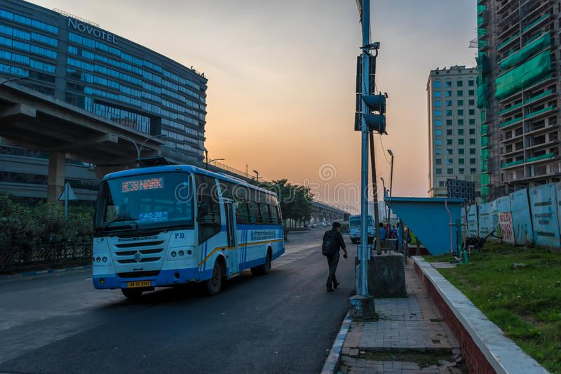 People getting on bus at shelter stop in New Town, Kolkata, India on December 2019 royalty free stock photos